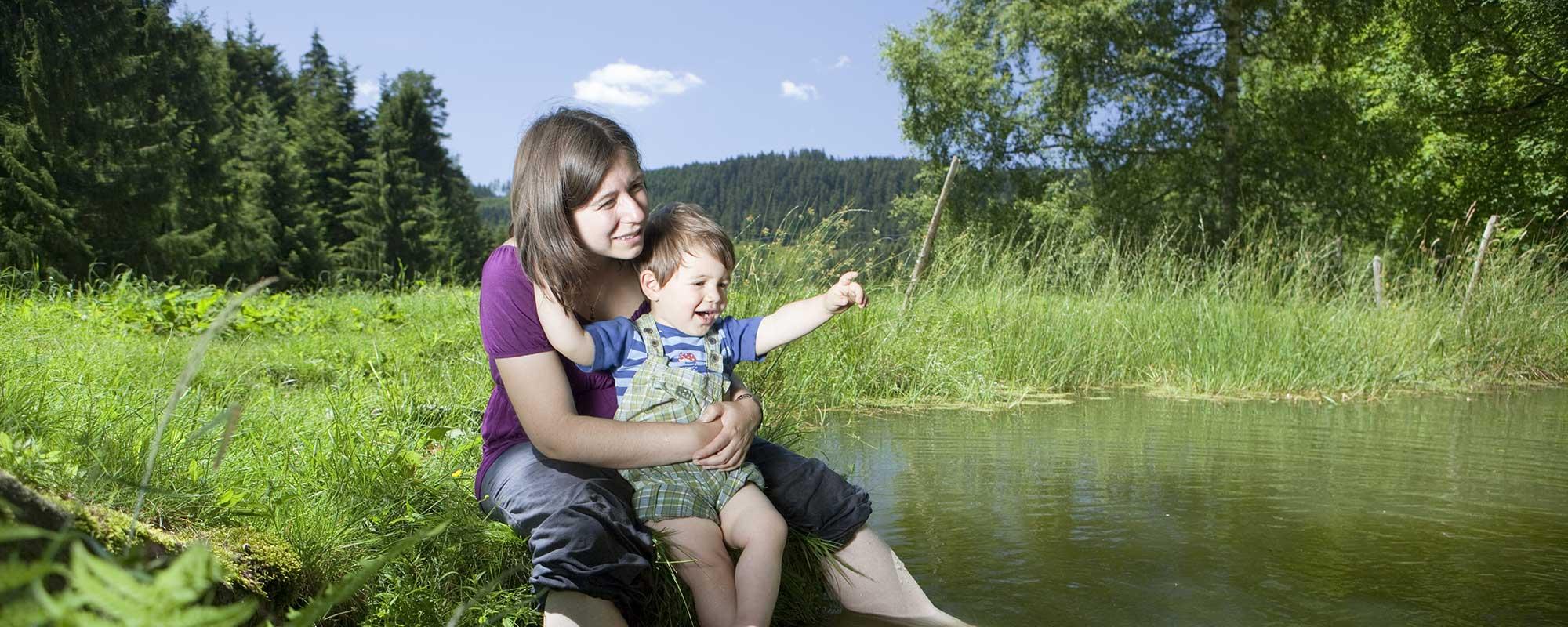 im Teich baden